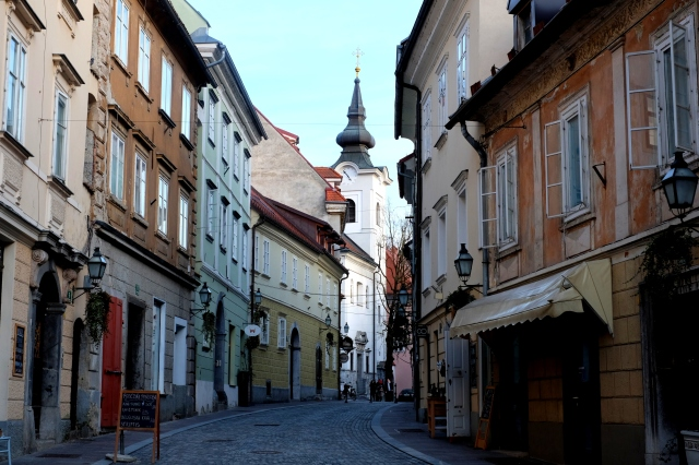 The most scenic way to the castle is from the Gornji Trg square at the beginning of the historic city center. It takes a turn to the left right before the church in the picture. Photo by: Exploring Slovenia.