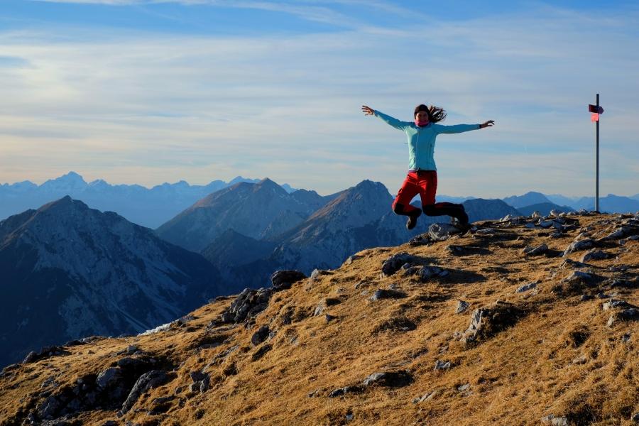 Happy hiker at the summit; Veliki vrh, Slovenia