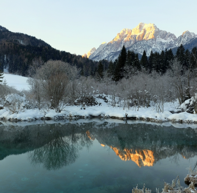 Mountains at the sunrise as seen from the Zelenci Springs