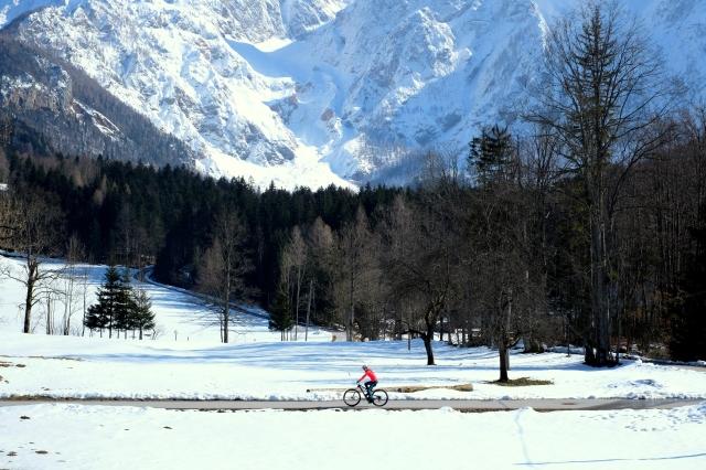 Cycling under high mountains; Jezersko, Slovenia