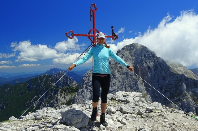 A woman hiker at the top of Mount Brana above Kamniško Sedlo, Slovenia