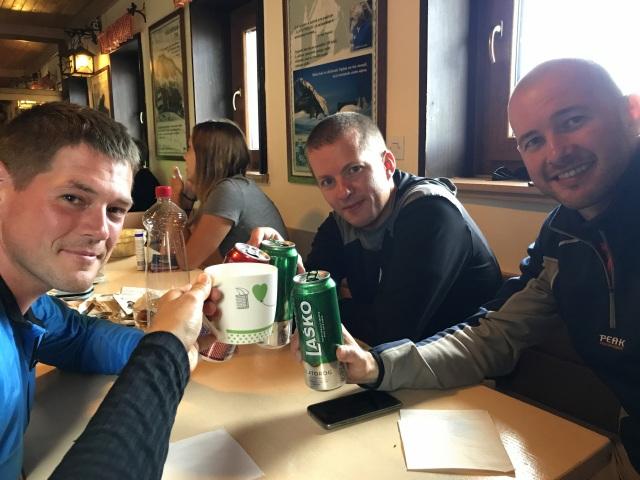 Friends toasting in the Kredarica Huts