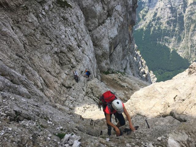 A female hiker climbing up to Triglav over the Prag Route