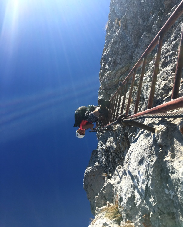 Climbing a via ferrata in Slovenia