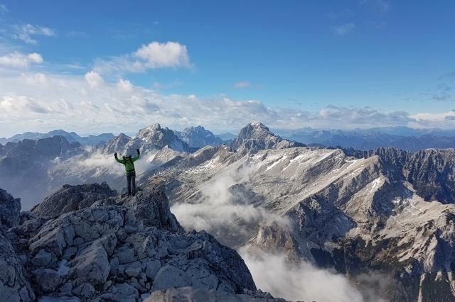 A female hiker on the top of Prisojnik, Julian Alps, Slovenia