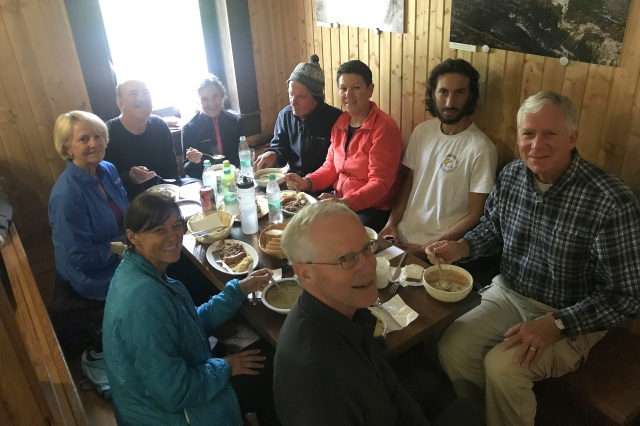 Our group of hikers eating lunch in the hut