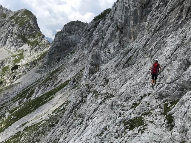 Crossing the steep slopes underneath Mt. Ojstrica and heading towards Mt. Planjava, Kamnik-Savinja Alps, Slovenia