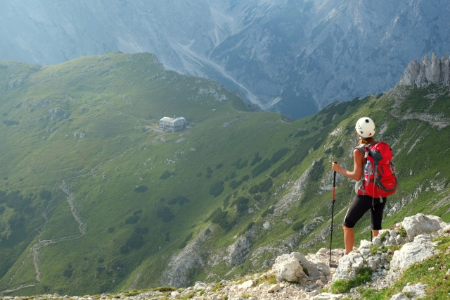Hiking towards the mountain hut on the Kamnik Saddle, Kamnik-Savinja Alps, Slovenia