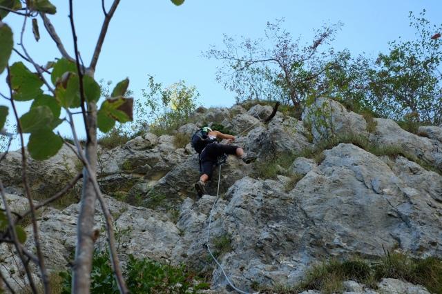 Climbing the via ferrata above Lake Bohinj, Ožarjeni Kamen, Triglav National Park, Slovenia