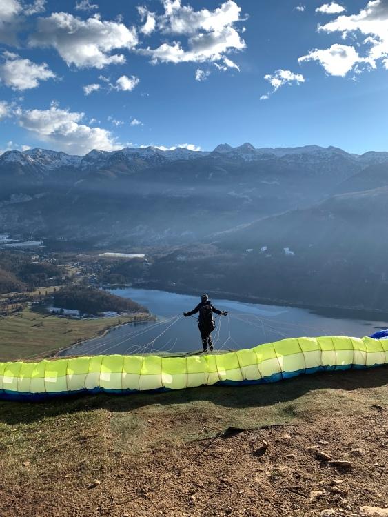 A paraglider taking off above Lake Bohinj, Julian Alps, mountains, Slovenia
